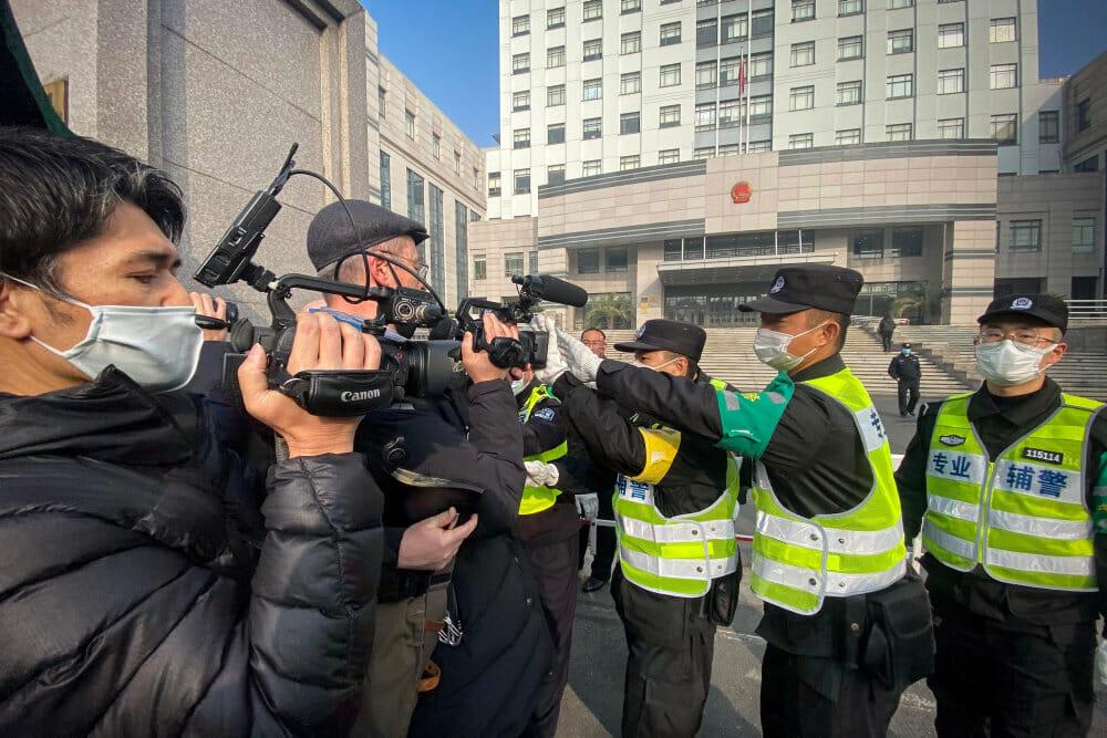 Kvinde får fire års fængsel for virusrapportering i Wuhan