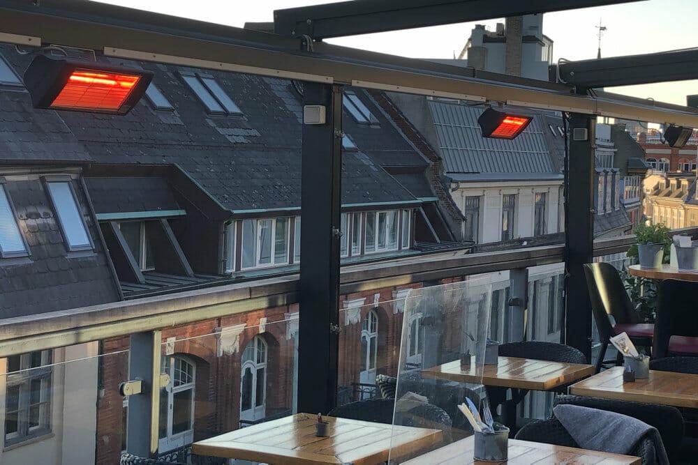 Caféers udendørs varmelamper får klimakritik